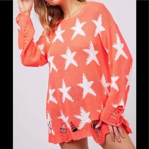 Sweaters - Star print distressed knit sweater